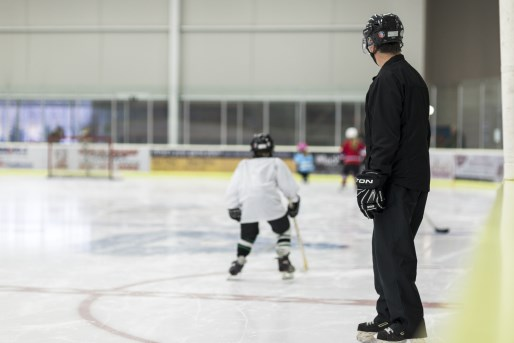 hockey instructor with child