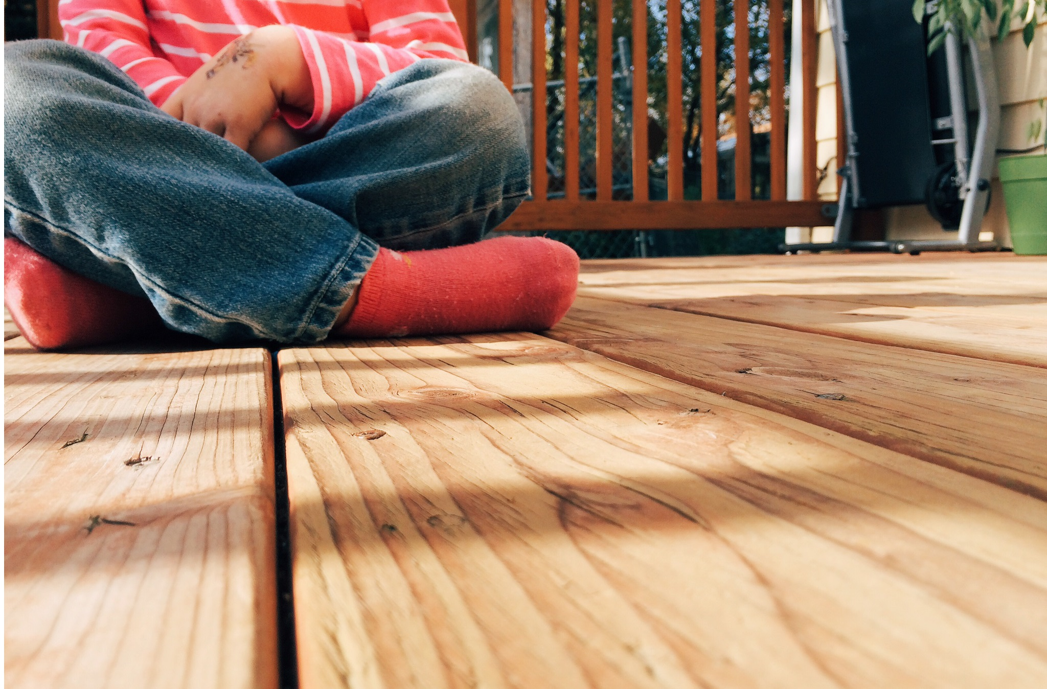 Photo of child sitting on deck by Jeri Johnson