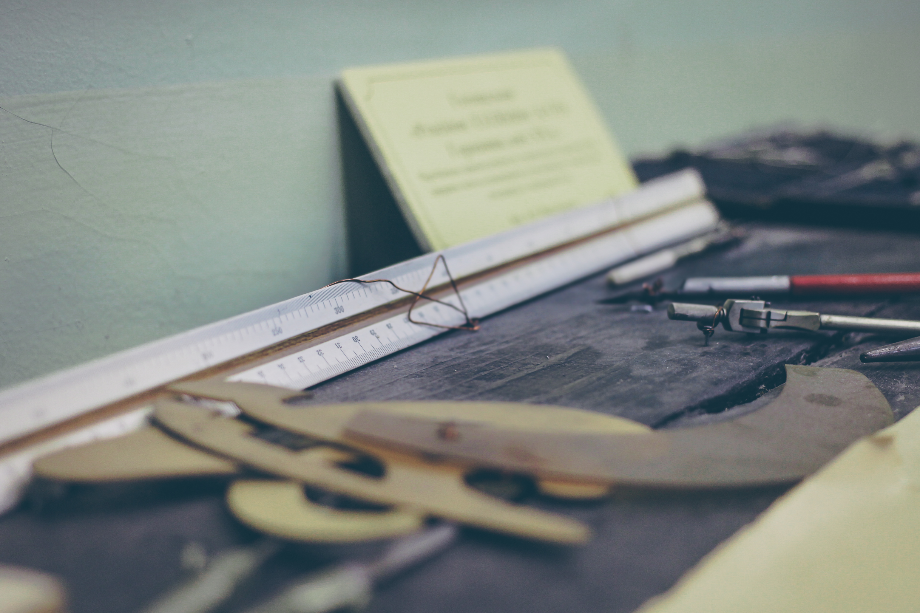 Photo of blueprints on desk by Szolkin